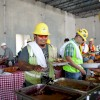 Hungry workers dig into a hearty meal provided by The Salt Lick Bar-B-Que